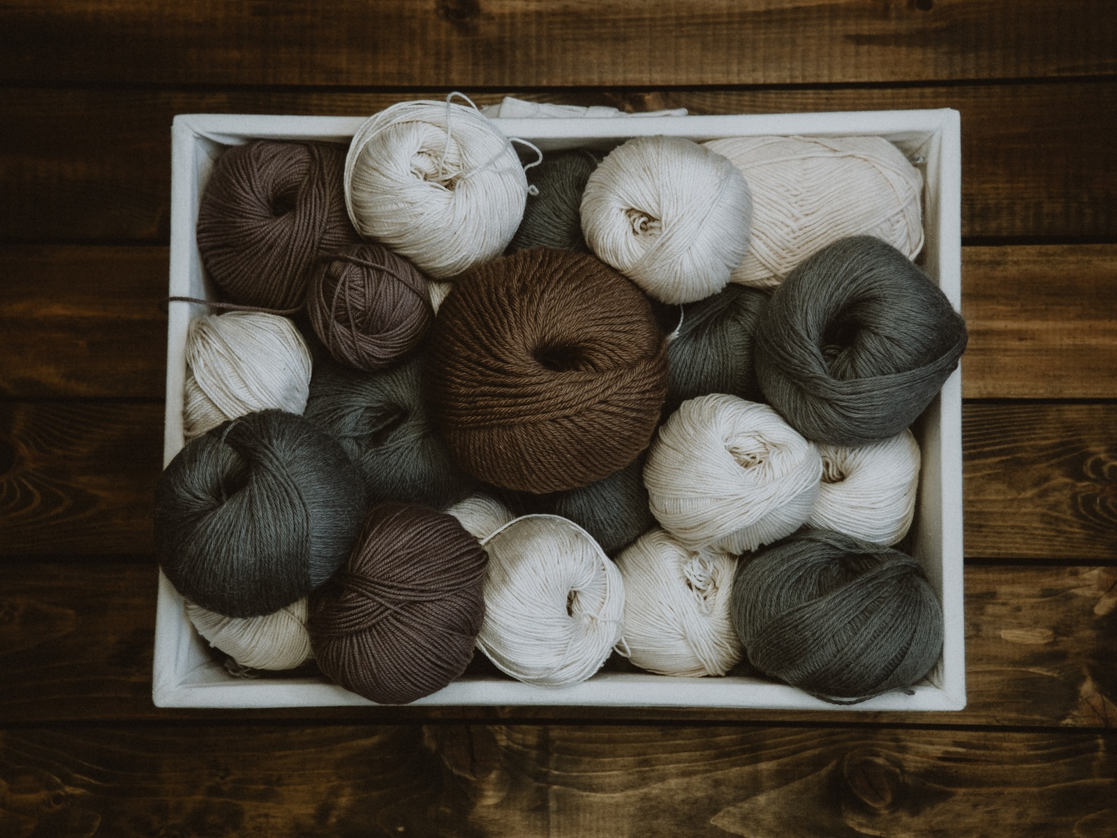 brown and white yarn ball lot